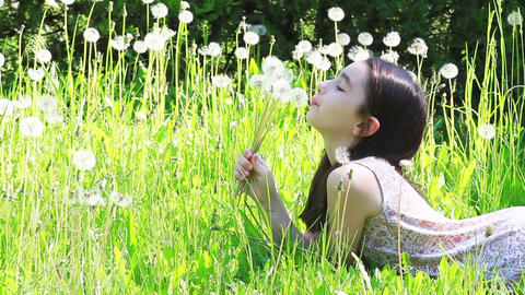 Little girl blowing dandelions 1 Footage