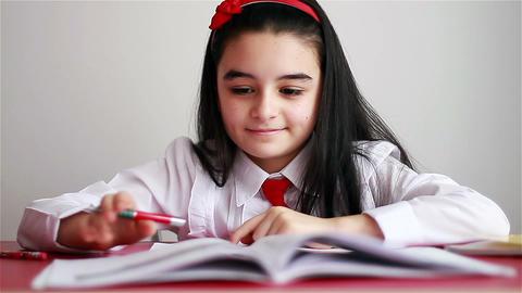 Schoolgirl doing her homework Footage