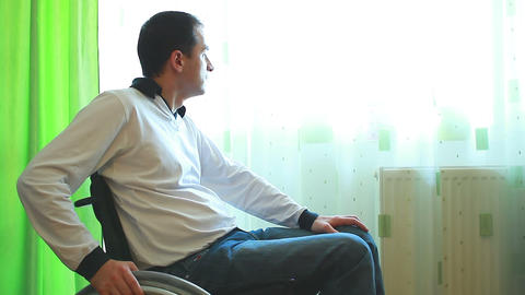 Man In A Wheelchair Looking Outside stock footage