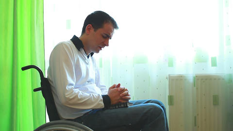 Man in a wheelchair praying Footage