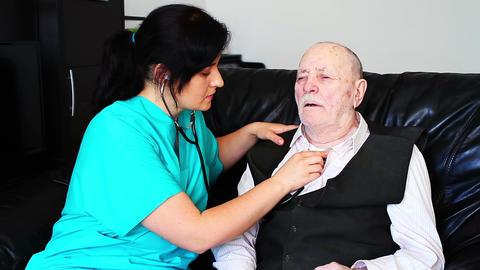 Nurse Consulting Sick Senior Man stock footage
