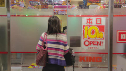 lady walking into a pachinko store in Kyoto Footage