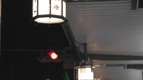 high to low tilt - close-up of lamp Kyoto Gion Footage