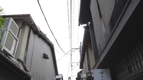 tilt - high to low in a small street in Gion Footage