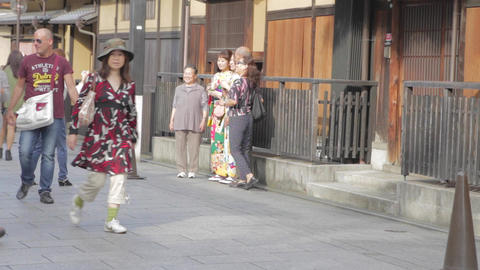 tourist posting for pictures with Gion women weari Footage