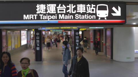 Sign - Taipei main station - passengers walking Live Action
