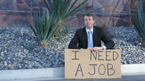 Businessman Sitting Need Job Sign stock footage