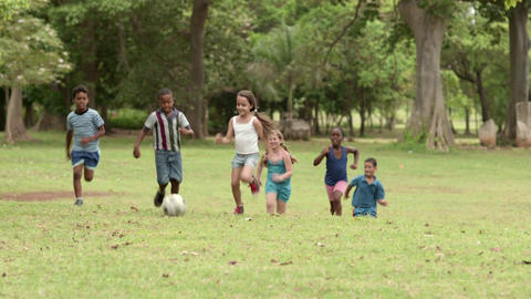 Happy Kids Running And Having Fun While Playing Soccer with ball Footage