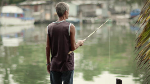 Leisure And Recreation With Senior Man Fishing For stock footage