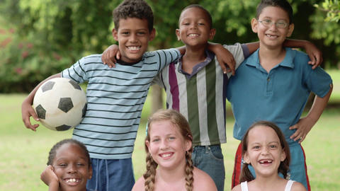 Multiethnic Group Of Happy Children Smiling With Soccer Ball Football Footage