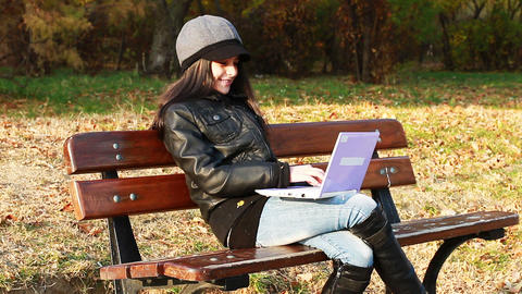Teenager Sitting On Bench With Laptop stock footage