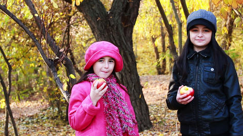 Two girls eating apples Footage