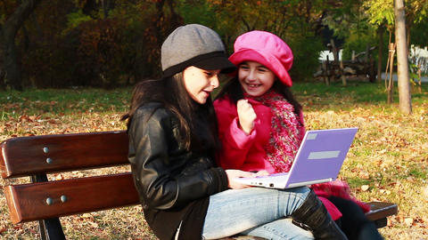 Two girls playing on laptop Footage