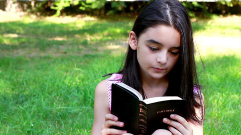 Young Girl reading Holy Bible Footage