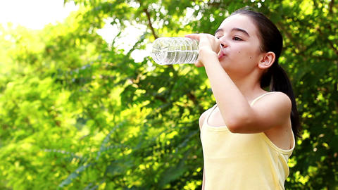 Young girl drinking water Live Action