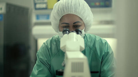 Female researcher working in pharmaceutical industry Footage