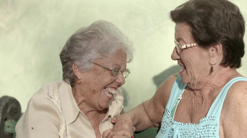 Active retirement and old women, two elderly female friends laughing, talking, s Footage