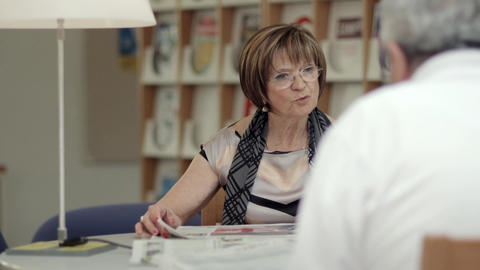 Retired Seniors, Elderly Woman Reading Paper With  stock footage