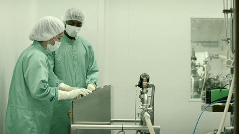 Laboratory Technicians At Work In Medical Plant Wi stock footage
