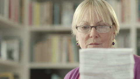 Elderly Caucasian Woman With Medicine And Reading  stock footage