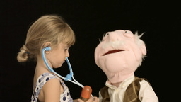 Little girl puppet doctor care Footage