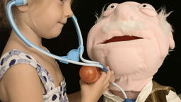 Little Girl Puppet Doctor Close Up stock footage