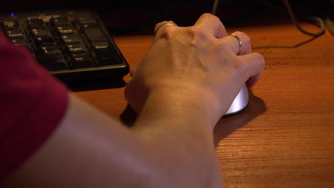 Female hand on computer mouse. 4K Footage