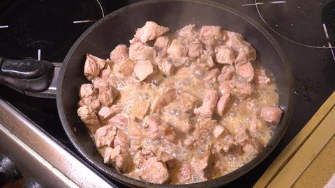 Roast meat in a skillet. 4K Footage