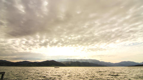 Timelapse of clouds moving over the lake Attersee Footage