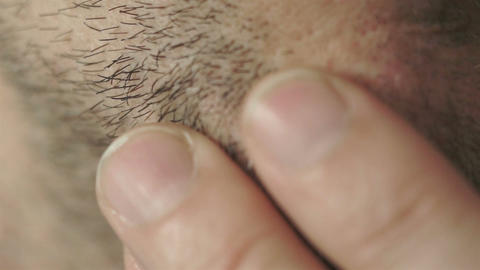 Male Rubs Facial Whiskers Macro Footage