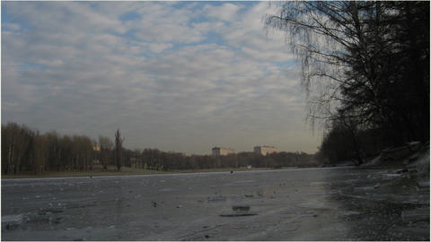 Pond in the city with ice and clouds in winter Footage