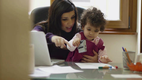 Multitasking Busy Woman Working At Home With Child Footage