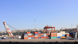 Industrial Seaport With Containers, Cranes And Tru stock footage
