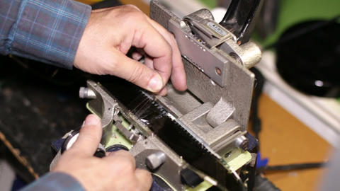 Film Technician Splicing 35mm Film stock footage