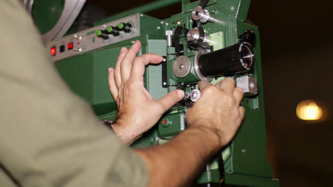 Film Technician Mounting 16mm Film Projector stock footage