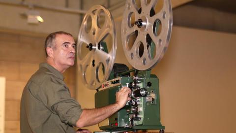 Cinema 12 Photo JPEGFilm Technician Projecting 16m stock footage