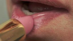 Woman Puts On Lipstick Macro stock footage