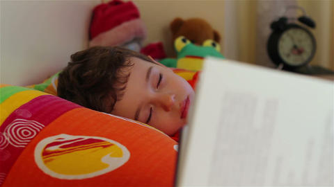 Reading story for little boy to sleep 2 Footage