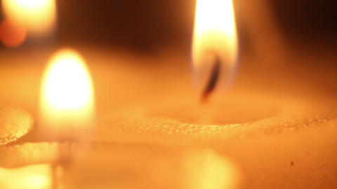 moving focus on burning candles close-up Footage