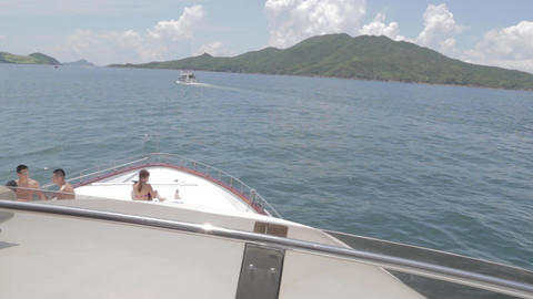 View of young people tanning from second deck of y Footage