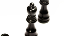 Black Chess Pieces Crossing In A Row stock footage