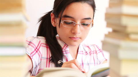 Teenage Girl Studying With Textbooks 1 stock footage