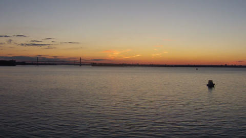 Sweeping Aerial Sunset on Bay, NYC Skyline in Shad Footage