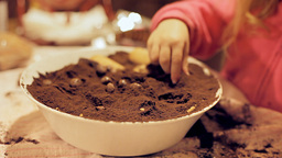 Little girl baking a cake shallow DOF Footage