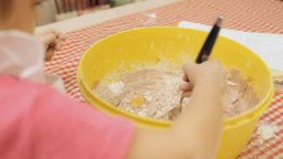 Little girl cooking cake mix A Footage