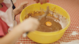 Little girl cooking cake mix C Footage