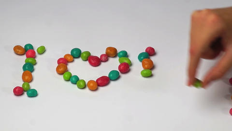 I Love You Of Colored Round Candy Time Lapse stock footage