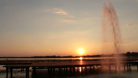 Fountain In The Lake At Sunset stock footage