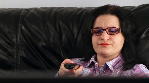 Young woman watching boring movie at TV 2 Footage