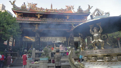 Longshan Temple - Woman bows at golden cauldron Footage